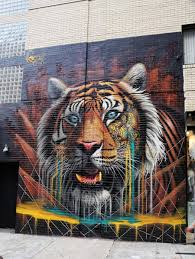 street artist sonny joins the cat fight to protect tigers new sonny tiger street art mural soho new york city project cat the