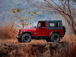 modified white jeep wrangler mahindra thar disguised as a jeep wrangler drivespark news