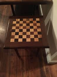 live edge black walnut chess board table outsiders carpentry