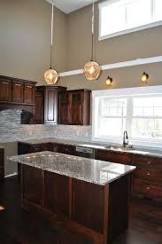 dark brown kitchen cabinets granite counter tops white trim