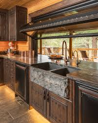 black kitchen cabinets with black appliances photos 75 beautiful kitchen with brown cabinets and black