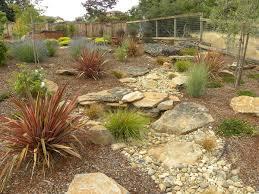using dry creek beds as a garden feature details landscape art