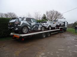 land rover camo discovery sport and range rover sport factory development vehicles