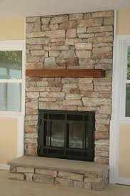 Cost Of Stone Fireplace by Covering A Gas Fireplace With Stone To Make It Look Real Re
