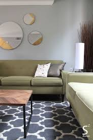 Mid Century Modern Living Room by Mid Century Modern Living Room Green Sofa Grey Rug Round Mirrors
