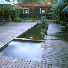 spa pool next to fish pondpond fed by fountain overflowdecking