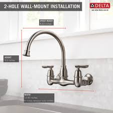 delta wall mount kitchen faucet two handle wall mounted kitchen faucet 22722lf ss delta faucet