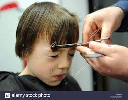 7 year old boys hair cuts 7 year old boy having a haircut at a barbers in great ayton