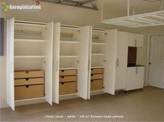 Woodworking Plans Garage Storage Cabinets by Custom Garage Storage Cabinets And Slat Wall Storage Systems