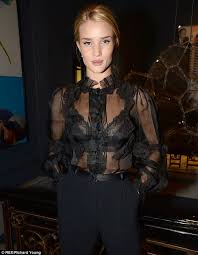 see thru blouse pics rosie huntington whiteley flashes lacy bra in a see through