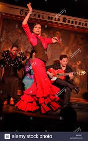 woman dancing flamenco in the flamenco restaurant corral de la