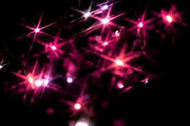 photo of christmas background of pink starburst lights free