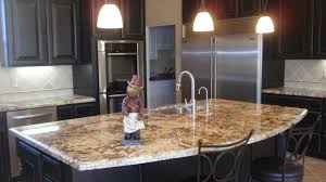 light granite countertops with dark cabinets i want this kitchen in my dream home i love the stainless steel too