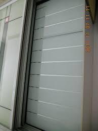 Retractable Closet Doors Kitchen Ideas Sliding Door Storage Retractable Cabinet Door