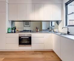 modern white kitchen backsplash l shape white kitchen decoration using modern mirrored kitchen