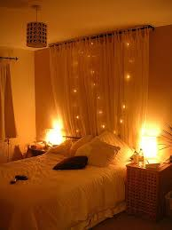 Hanging Christmas Lights In Bedroom by Hang A Curtain Behind A Bed With String Lights Very Pretty And