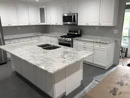 white kitchen cabinets with river white granite river white granite
