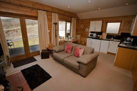 romantic pine lodges with tubs in scotland for two