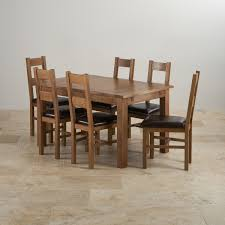 extending table rushmere extending dining table in rustic oak 6 leather chairs