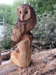 chainsaw carving of owls na3 in garden patio garden ornaments