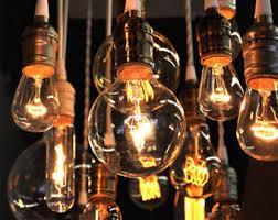 nostalgic reclaimed wood chandelier with varying edison bulbs