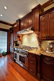 recycled countertops kitchen with cherry cabinets lighting