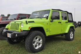 jeep sahara green 325 65 18 on stock 2013 sahara rims