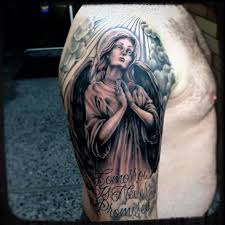 men shoulder cover up with simple praying angel and words tattoo