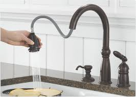 delta single handle kitchen faucet three hole mount under cover