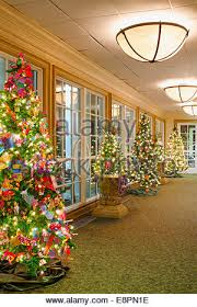 a row of trees decorated with crafted ornaments