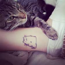 charming black color ink chubby cat tattoo on ankle for girls