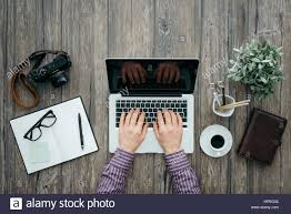 hipster freelance working at office desk he is networking and