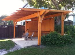 cypress pergola with a metal roof designed and built by finewood