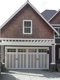 what do you guys think of garage door overhangs eyebrows for