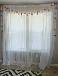 Mosquito Net Curtains by Pom Pom Curtain Swag Diy The Aspiring Home