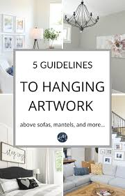 what height to hang cabinets m interiors the right height to hang artwork