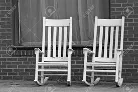 White Rocking Chair Empty White Rocking Chairs On City Street Stock Photo Picture And
