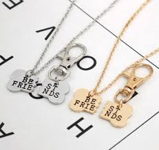 best necklace stores images Best friends broken dog bone necklace and keychain snatched up store png