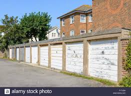 row of private car garages in england uk stock photo royalty