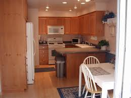 kitchen lighting countertops ceiling sink cabinet home