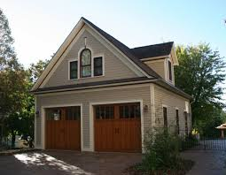 building a garage with an apartment above garage door decoration double garage doors for large garages where a person tends to work on their car there is more room in a large garage for this purpose