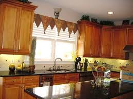 kitchen with wooden cabinets and triangle valance creating