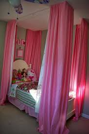 curtain over bed hanging curtains over bed ideas 24 spaces
