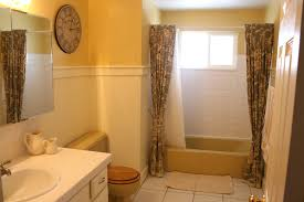 Color Scheme For Bathroom - mustard yellow tub and toilet updated bathroom