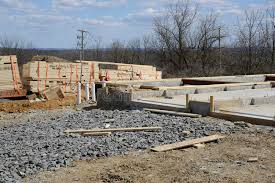 new home foundation wood by a cement foundation for a new home construction stock image