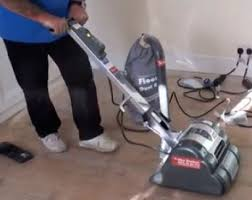 Sanding Floor by Sanding A Timber Floor Using A Floor Sander On Wooden Flooring