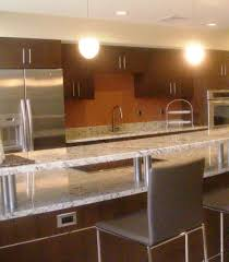 stainless steel kitchen backsplash how to set cabinets corian