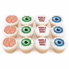 twelve personalised halloween cupcakes with brains and eyeballs