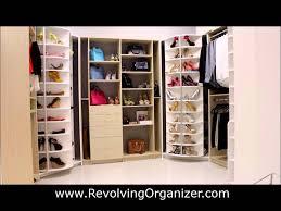closet organizer in a walk in closet revolving shoe rack named