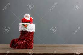 santa claus doll stand in sock festive ornaments merry